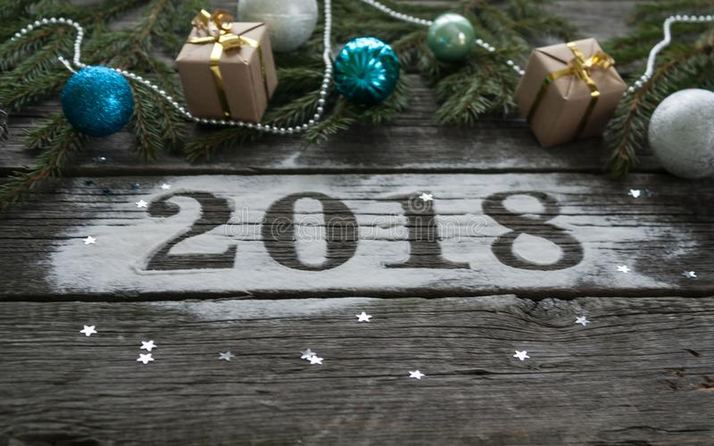 Feliz Año Nuevo y Feliz Navidad Poner letras a 2018 imagen de archivo