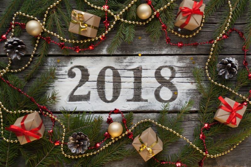 Feliz Año Nuevo y Feliz Navidad Poner letras a 2018 fotos de archivo