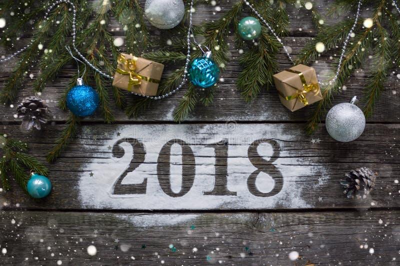 Feliz Año Nuevo y Feliz Navidad Poner letras a 2018 foto de archivo