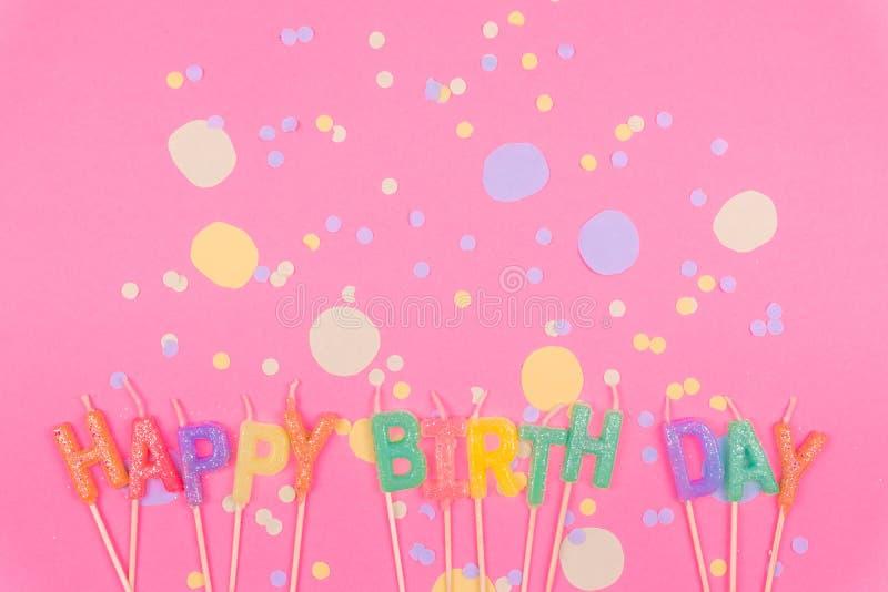 Feliz aniversario colorido no rosa fotos de stock royalty free