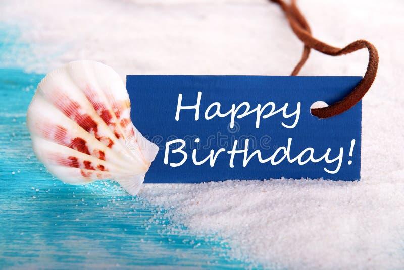 Feliz aniversario no fundo da praia fotos de stock royalty free