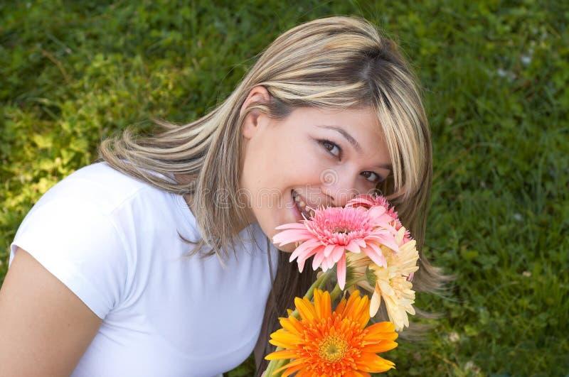 Feliz com flores fotografia de stock