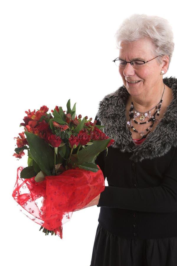 Feliz com suas flores imagem de stock royalty free