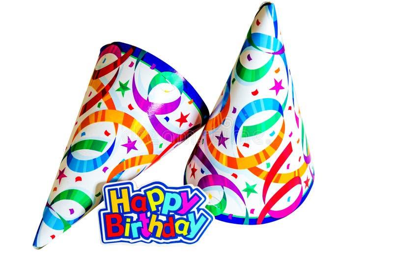 Feliz cumpleaños con los sombreros imágenes de archivo libres de regalías