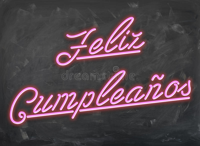Feliz Cumpleanos - Pink Neon Font on handwiped dark Chalk Board.  stock photos