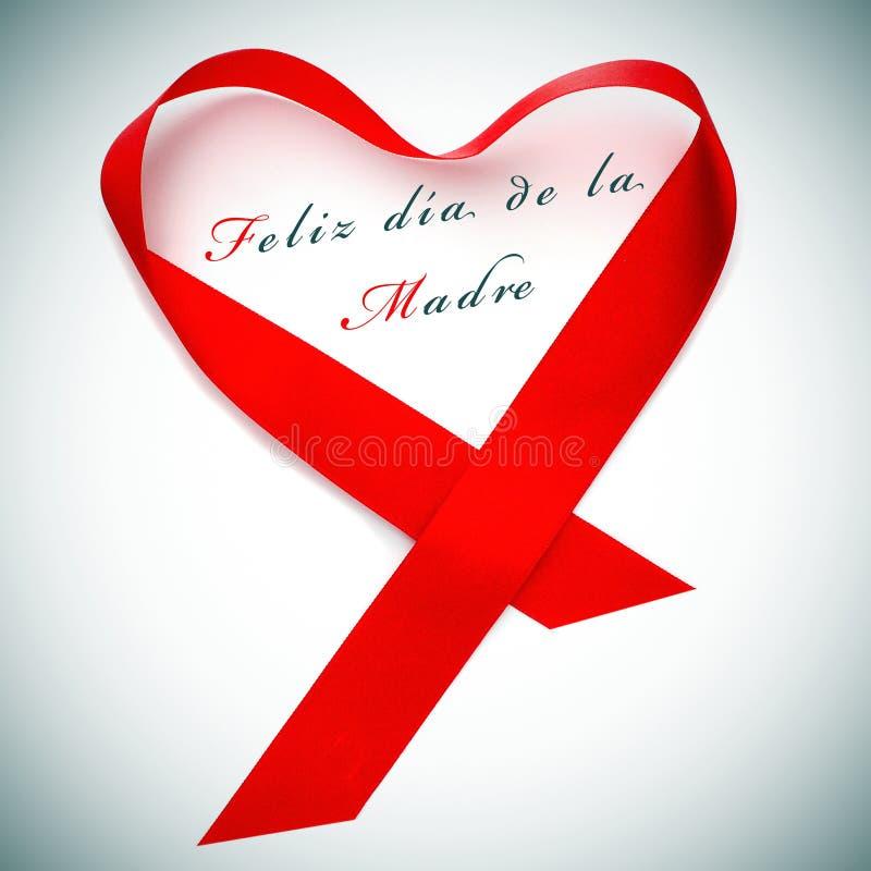 Feliz dia de Ла madre, счастливый день матерей написанный в испанском языке стоковое изображение rf