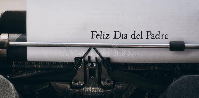 Feliz dia del padre written on paper stock photography