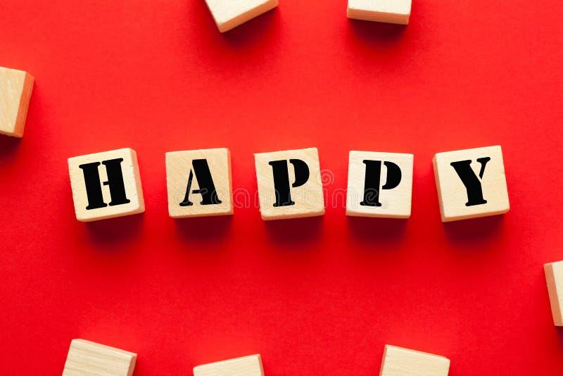 Feliz escrito em cubos imagem de stock