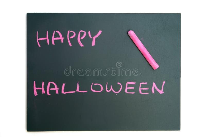 Feliz Halloween con tiza roja en la pizarra foto de archivo