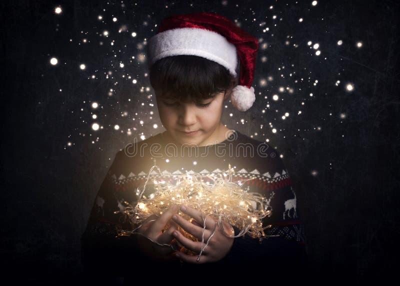 Feliz Natal, criança com luzes de Natal fotografia de stock royalty free