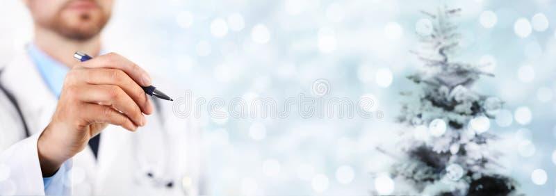 Feliz Natal do doutor, cumprimentos conceito, doutor t da mão fotos de stock royalty free