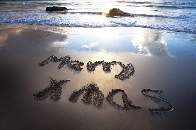 Feliz Natal no bech imagens de stock