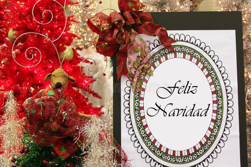 Feliz Navidad. Written on a board in a Christmas setting royalty free stock image