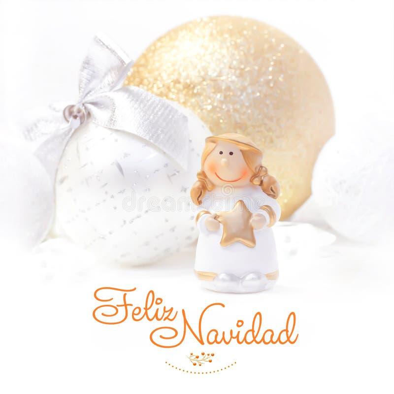 Feliz Navidad. Christmas and New Year background 2017. Golden angel. Christmas tree toy. royalty free stock photo