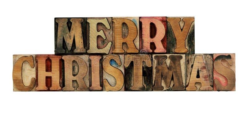 Feliz Navidad en tipo de madera de la prensa de copiar fotografía de archivo