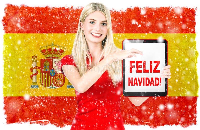 Feliz Navidad española Feliz Navidad de la bandera nacional de la mujer joven imágenes de archivo libres de regalías