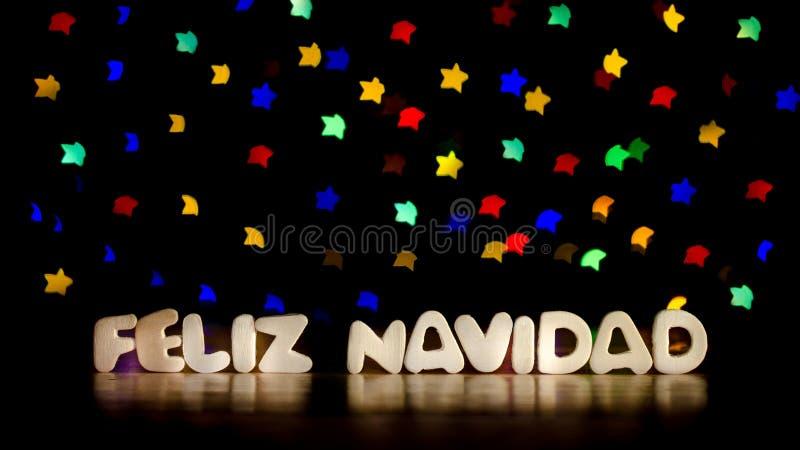 Feliz navidad, glad jul i spanskt språk royaltyfri fotografi