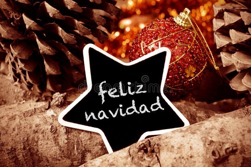 Feliz navidad, merry christmas in spanish royalty free stock photo