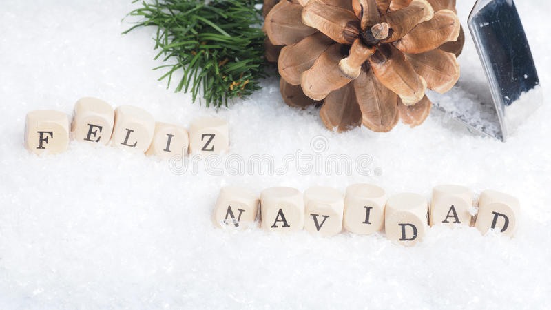 Feliz Navidad in snow. Christmas background with the Spanish words Feliz Navidad of Merry Christmas royalty free stock photography