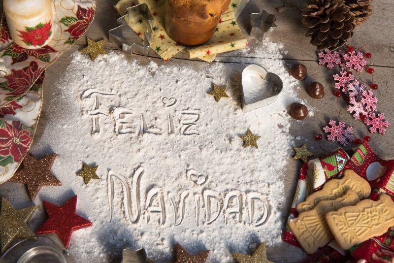Feliz Navidad, texto espanhol feito com a farinha, cercada por Chris fotos de stock royalty free