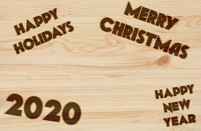 Feliz Navidad y Feliz Año Nuevo 2020 Antecedentes. Quemado en madera foto de archivo libre de regalías