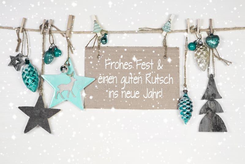 Feliz Navidad y una Feliz Año Nuevo: tarjeta de Navidad con el texto alemán imagen de archivo libre de regalías