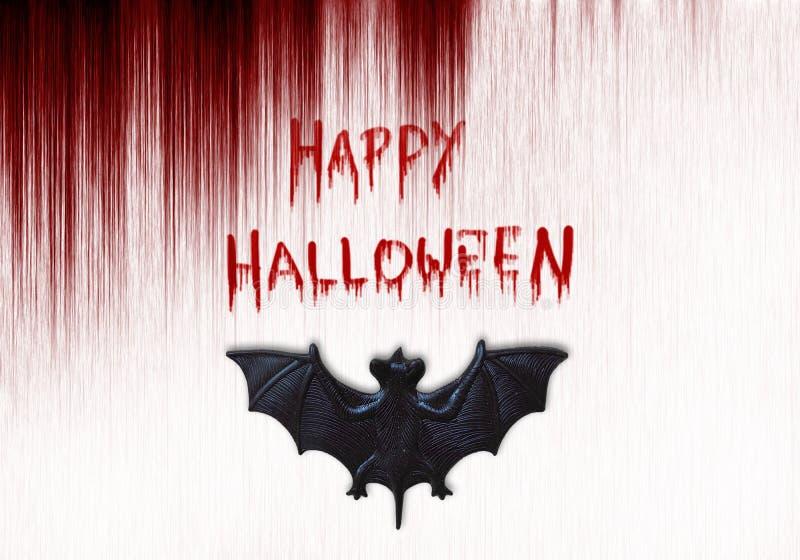Feliz texto de Halloween Bate sobre fondo sangriento fotos de archivo libres de regalías