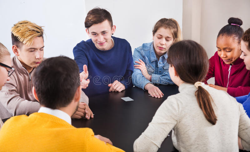 Fellow students playing Mafia game at recess stock images