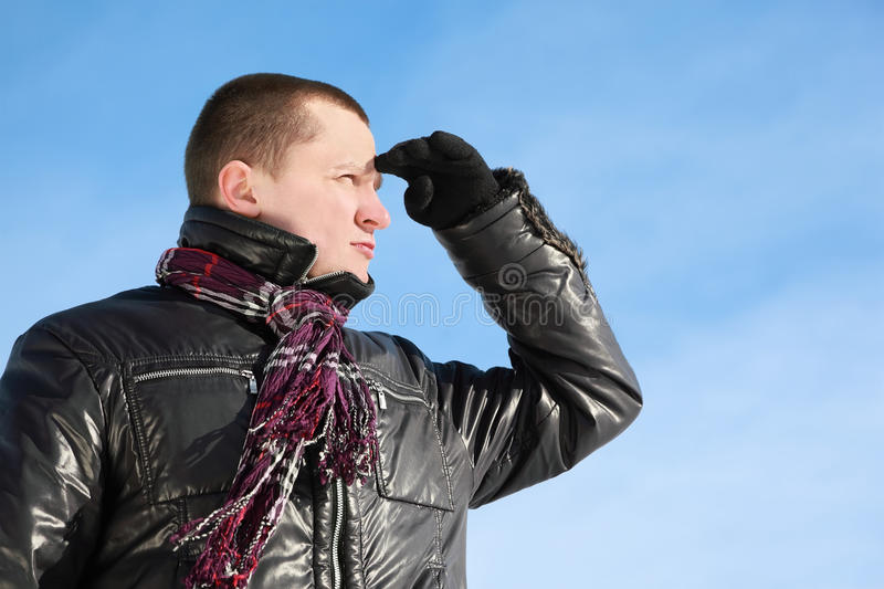 Fellow By Winter Day Looks Far Stock Photo