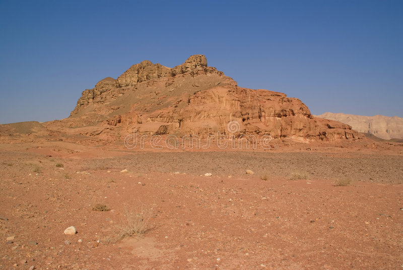 Felsen und rotes Gelände stockbilder