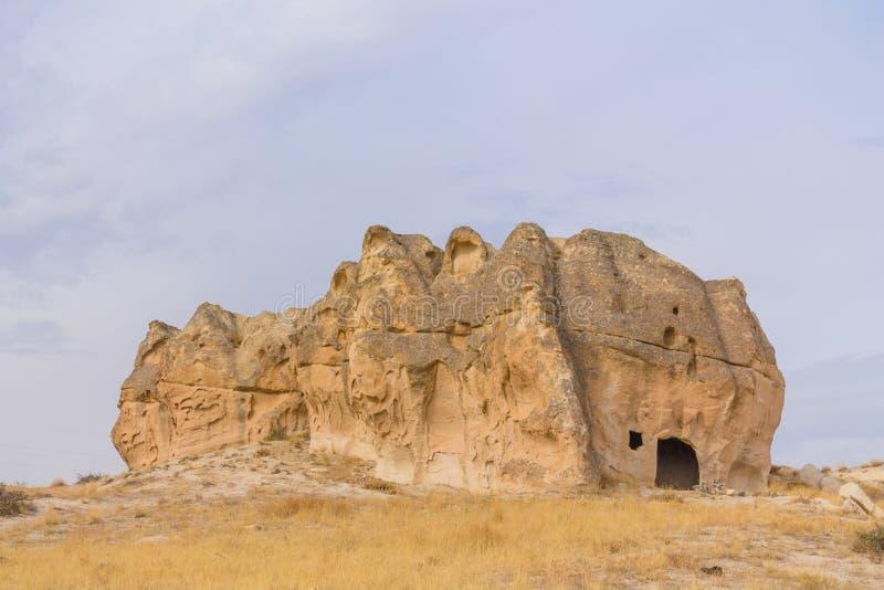 Felsformationstuff-Höhlenstadt auf Türkisch Cappadocia stockfoto