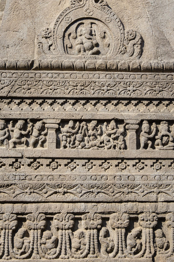 Felsritzungsbeschaffenheitshintergrund von Ajanta-Höhle in Aurangabad, Indien lizenzfreies stockbild