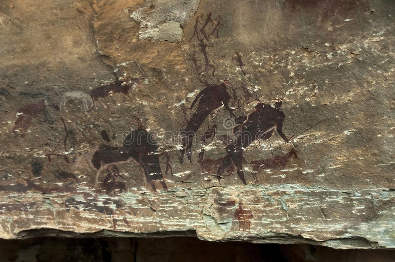 Felszeichnung von langen letzten San-Leuten (Buschmann) in der Giants-Schloss-Höhle lizenzfreie stockbilder