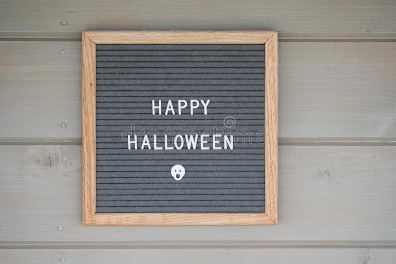 Felt Board in a wooden frame with the inscription happy Halloween. In English. letterboard on the wooden wall of the house royalty free stock photos