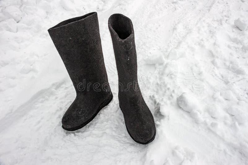 Felt boots on the snow. Russian footwear - valenki stock photography