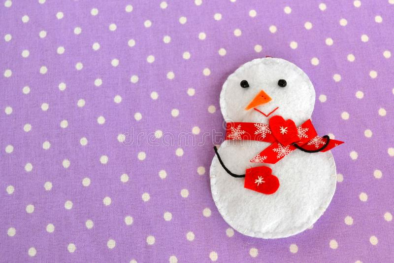 Handmade felt Christmas snowman toy. Homemade felt crafts royalty free stock photography