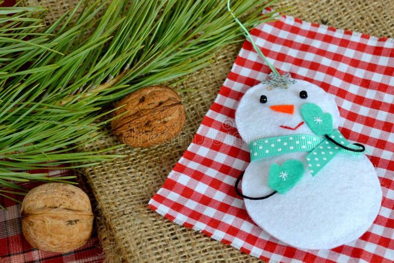 Handmade felt Christmas snowman toy. Felt decoration. Felt Christmas ornaments. Felt Christmas ornaments ideas. Christmas tree ornament. Felt crafts. Christmas royalty free stock photography