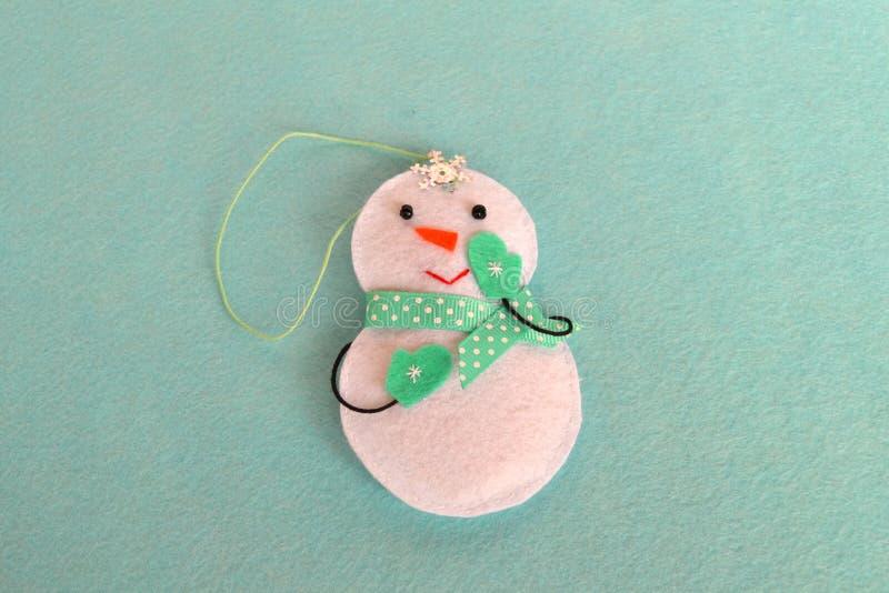 Felt Christmas snowman toy. Homemade felt crafts. Felt Christmas ornaments. Felt Christmas ornaments ideas. Christmas tree ornament. Felt crafts. Christmas royalty free stock images
