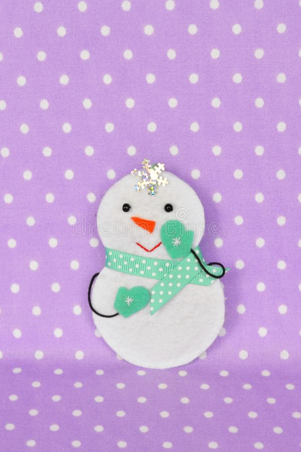 Felt Christmas snowman toy. Homemade felt crafts royalty free stock photos
