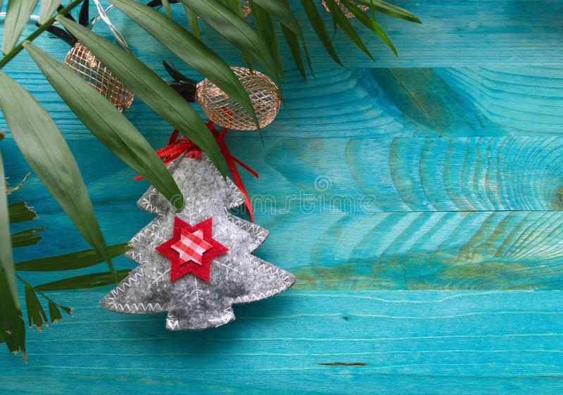 Felt christmas tree palm leaf and pineapple illumination lights. Concept image of tropical winter holidays with felt christmas tree palm leaf and pineapple royalty free stock photography