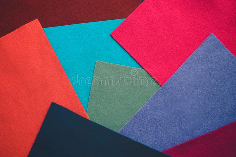 Felt color textile. Samples of soft felt flaps in different colours. Fan of colored bright textile material. Felt craft abstract stock images