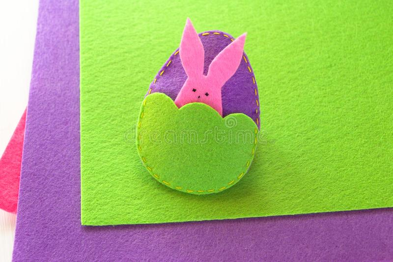 Felt Easter egg and bunny. How to make handmade Easter ornament. Sewing concept. Step royalty free stock photo