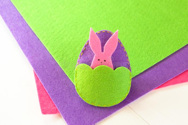 Felt Easter egg and Bunny - how to make handmade toy. Sewing. Step stock photo