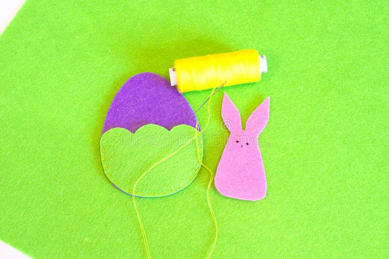 Felt Easter egg and bunny ornament. How to make handmade Easter ornament. Sewing craft concept. Kids sewing. Step royalty free stock photography