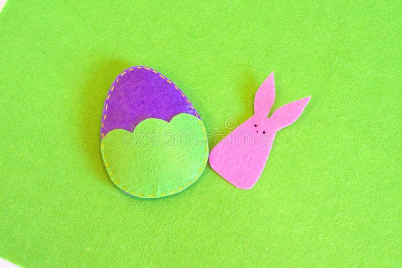 Felt Easter egg and bunny ornament. How to make handmade Easter ornament. Sewing craft concept. Step stock photo