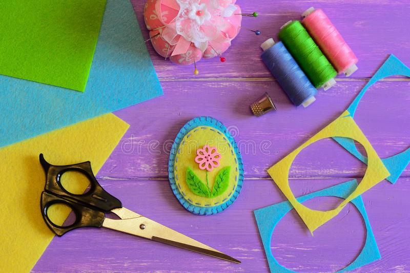 Felt Easter egg decoration with flower. Simple Easter crafts for children. Sewing crafts idea. Materials and tools. Easter crafts for kids. Fun DIY idea. DIY for stock images