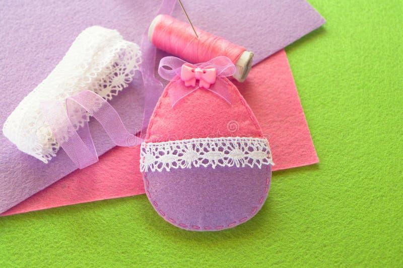 Felt Easter egg, handmade toy. DIY Easter ornament. Adorable DIY Easter ornament royalty free stock photography