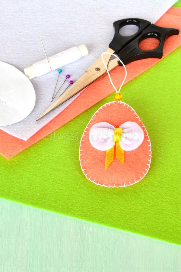 Felt Easter eggs - handmade crafts. Simple kids sewing stock photos