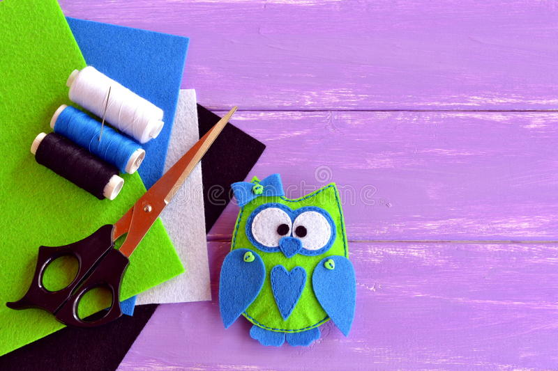 Felt hand print owl stuffed toy. Felt owl softie toy. Hand-sew owl stock photos