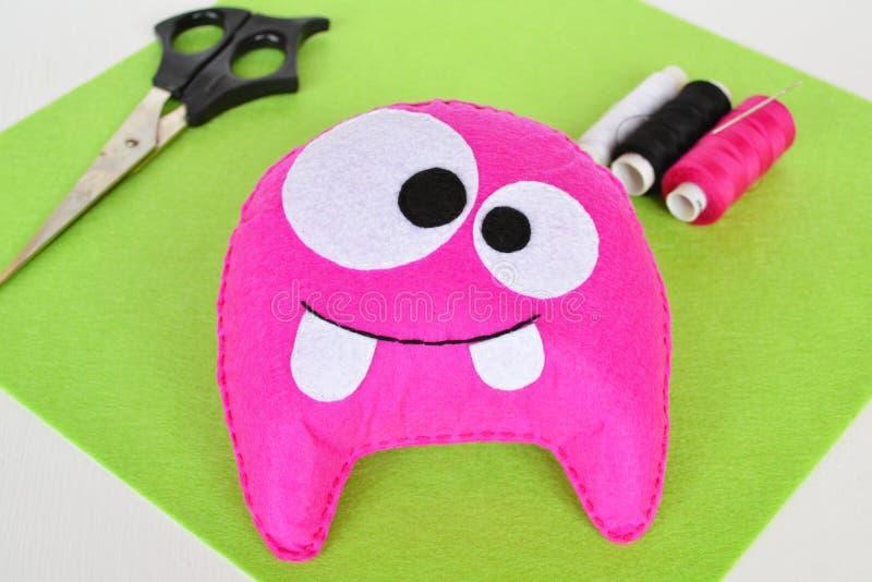 Pink felt monster - handmade toy stock photography